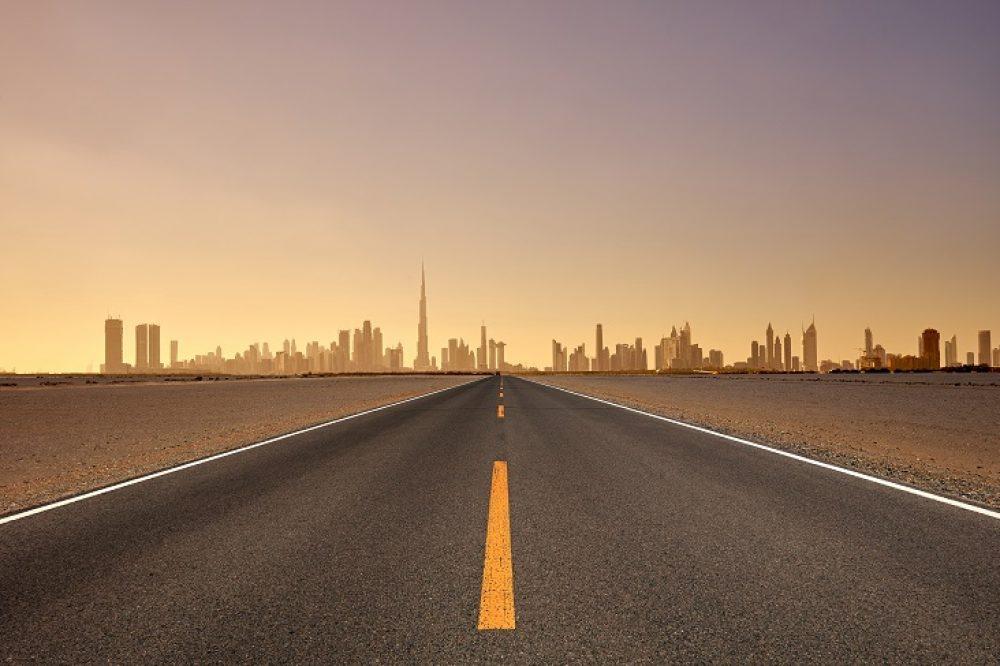 Dubai Skyline and Highway at Sunset, United Arab Emirates